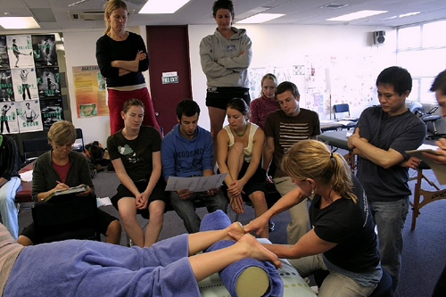 Massage Teacher Demonstrating On Student in Class